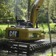 Excavadora anfibia CAT