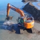 Excavadora Doosan DX235LCR-5 repara los destrozos en el Delta del Ebro
